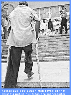 Picture of a disabled man negotiating stairs outside a building