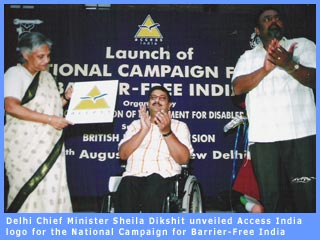 Picture of Delhi Chief Minister Sheila Dikshit unveiling logo for access campaign