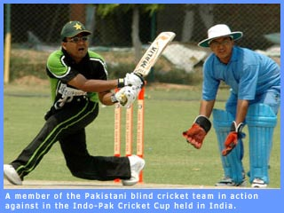 Picture of a Pakistani player in action against Indian team in Indo-Pak cricket match