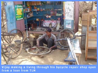 Picture of Vijay a bycyle repair shop funded by TLM