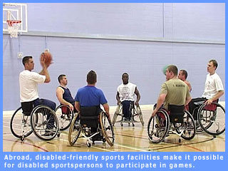 Picture of people abroad playing a game of wheelchair basketball
